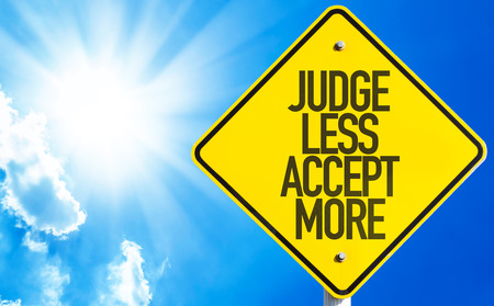 Judge less accept more sign with sunny background
