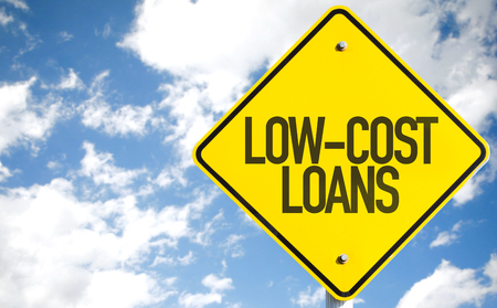 loans: Low-cost loans sign with clouds and sky background Stock Photo