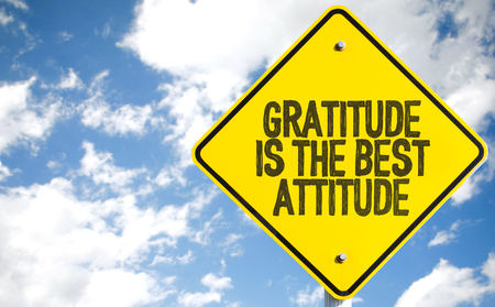 gratefulness: Gratitude is the best attitude sign with clouds and sky background