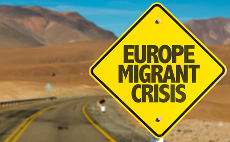 Europe migrant crisis sign on a highway background