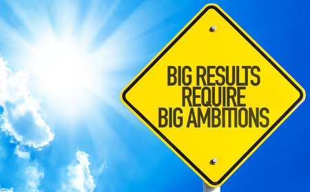 ambitions: Big results require big ambitions sign with sunny background