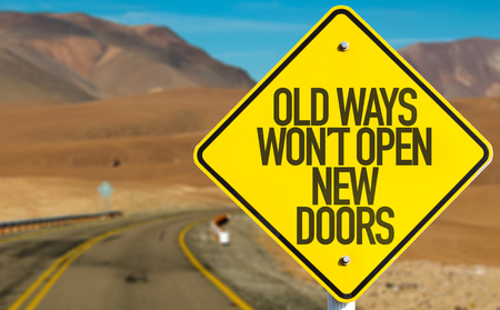 Old ways wont open new doors sign on a highway background