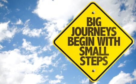 big sign: Big Journeys Begin With Small Steps sign with sky background