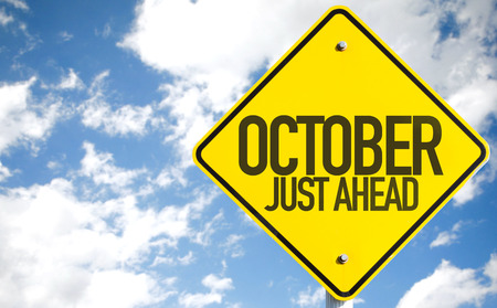 just ahead: October Just Ahead sign with sky background