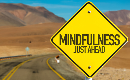 Mindfulness Just Ahead sign with desert background Stock Photo