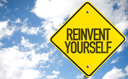 yourself: Reinvent Yourself sign with sky background Stock Photo