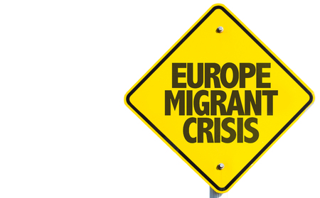 migrant: Europe Migrant Crisis sign with road background