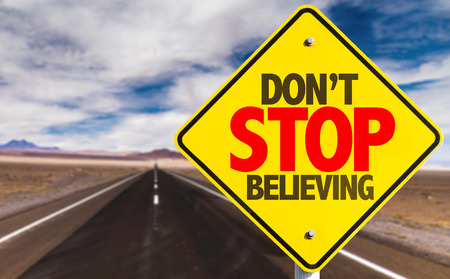 believing: Dont Stop Believing sign on road