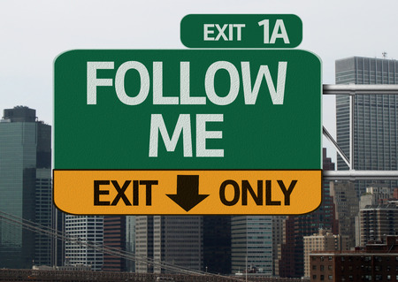 free me: Follow Me road sign with urban background