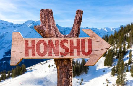 honshu: Honshu wooden sign with winter background