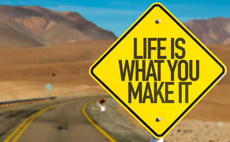 street wise: Life Is What You Make It sign on desert road