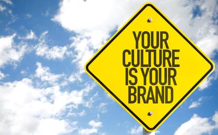 identidad cultural: Su cultura es su signo de la marca de f�brica con fondo de cielo Foto de archivo