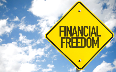 debt goals: Financial Freedom sign with sky background Stock Photo