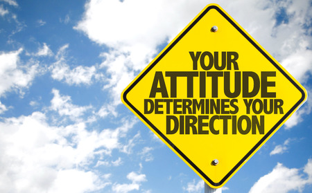 determines: Your Attitude Determines Your Direction sign isolated on sky background