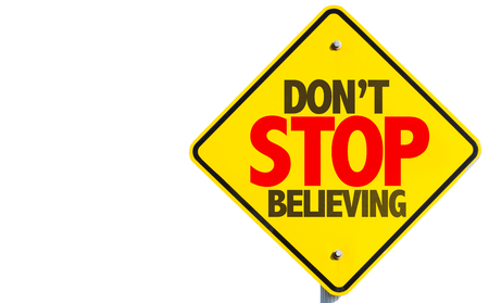 believing: Dont Stop Believing sign isolated on white background