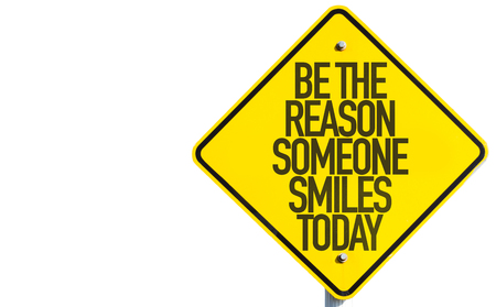 courteous: Be The Reason Someone Smiles Today sign with sky background Stock Photo