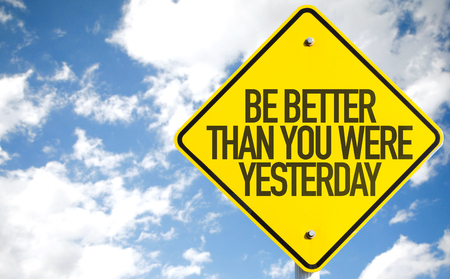 better: Be Better Than You Were Yesterday sign with sky background Stock Photo