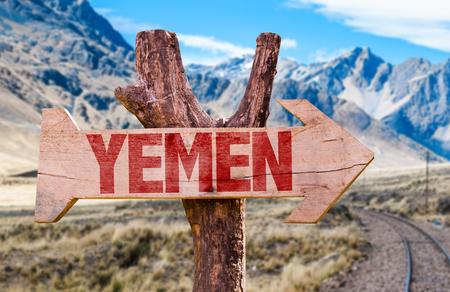 yemen: Yemen wooden sign with desert road background
