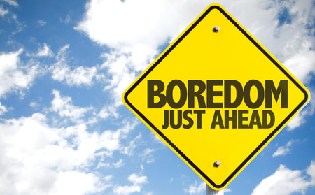tiresome: Boredom Just Ahead sign with sky background