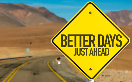 better days: Better Days Just Ahead sign with desert background Stock Photo