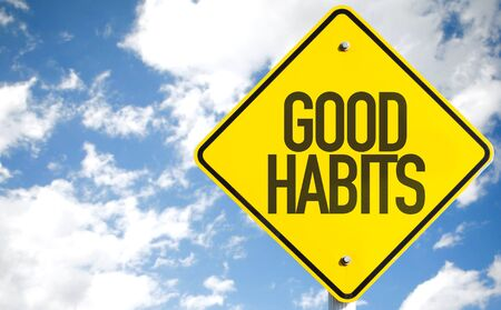 habits: Good Habits sign with sky background Stock Photo