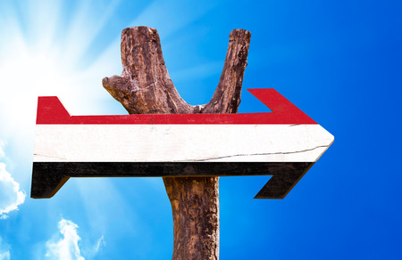 signpost: Yemen wooden sign with sky background