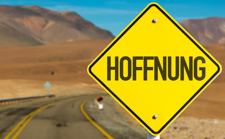future sign: Hope in German sign on desert road