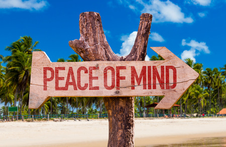 Peace of Mind arrow with beach background Stock Photo
