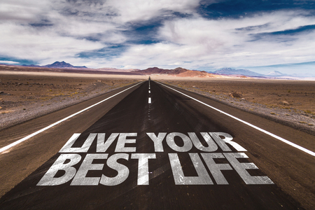 best quality: Live Your Best Life written on desert road Stock Photo