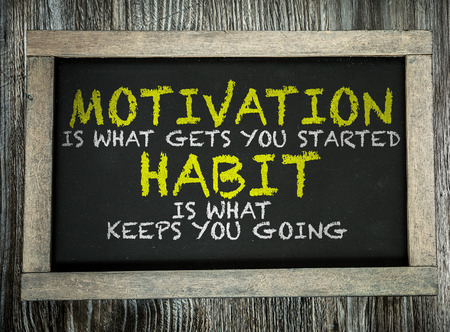 habit: Motivation is What Gets You Started Habit Is What Keeps You Going written on chalkboard