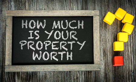 How Much is Your Property Worth written on chalkboard 版權商用圖片 - 49538467