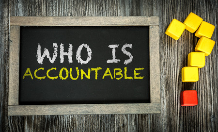 justify: Who Is Accountable written on chalkboard