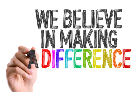 the difference: Hand with marker writing: We Believe in Making a Difference