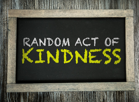 Random Act of Kindness written on chalkboard