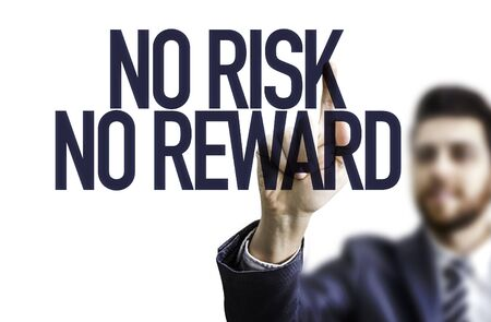 business risk: Business man pointing the text: No Risk No Reward Stock Photo