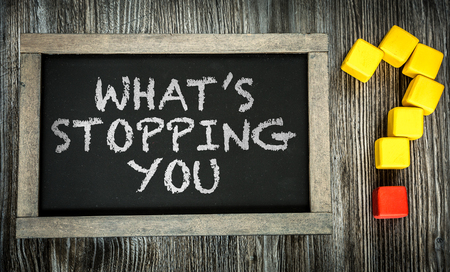 stopping: Whats Stopping You written on chalkboard Stock Photo