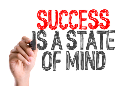 winning mood: Hand with marker writing: Success Is a State of Mind