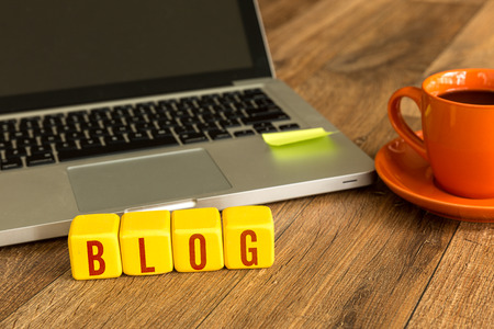 keywords link: Blog written on a wooden cube in front of a laptop Stock Photo