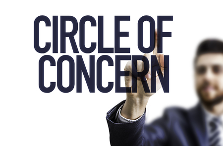 business concern: Business man pointing the text: Circle of Concern