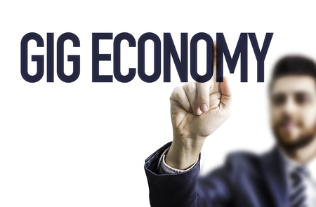 Business man pointing the text: GIG Economy Stock Photo