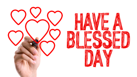 Hand with marker writing the word Have a Blessed Day Stock Photo