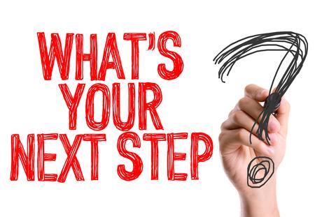 Hand mit Marker Schreiben: Was ist Ihr nächster Schritt