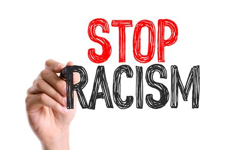 racismo: Mano con la escritura marcador: Stop Racismo
