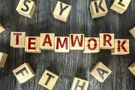 combined effort: Wooden Blocks with the text: Teamwork Stock Photo