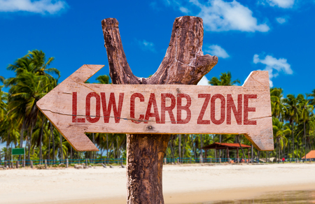 low carb diet: Low Carb Zone arrow with beach background Stock Photo