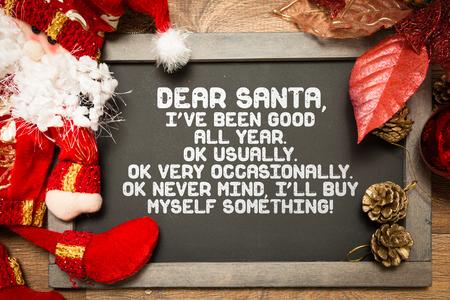 weihnachtsmann lustig: Tafel mit einem Weihnachts Lustiger Text in einem konzeptionellen Bild Lizenzfreie Bilder