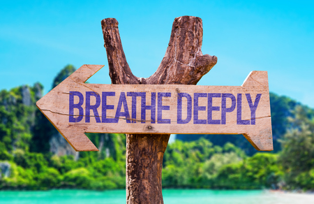 deeply: Breathe Deeply arrow with beach background Stock Photo