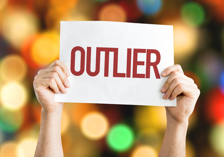 oddity: Outlier placard with bokeh background Stock Photo