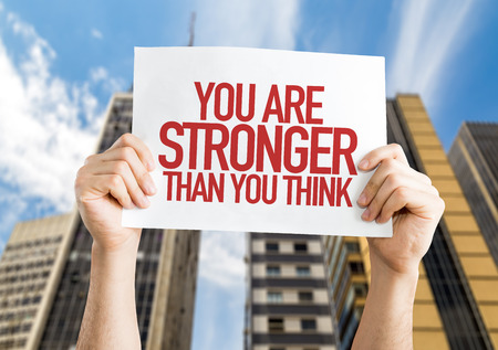 stronger: You Are Stronger Than You Think placard with urban background