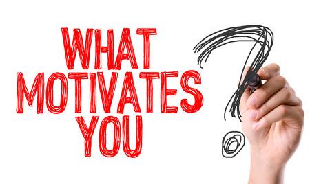 Hand met teller het schrijven: Wat motiveert je